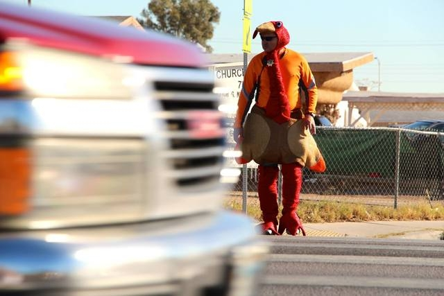 A police officer dressed in a turkey suit was the center of attention at the intersection of Martin Luther King Boulevard and Balzar Avenue Tuesday, testing motorists' attention to traffic laws. T ...