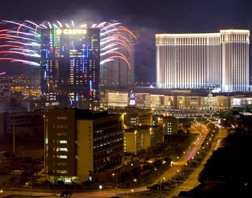 Fireworks explode at the City of Dreams, left, one of the giant casino complex in Macau, Monday, June 1, 2009. City of Dreams is an urban entertainment resort, feature a 420,000 square foot casino ...