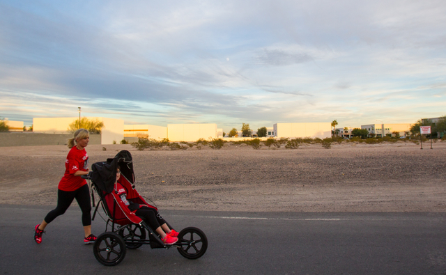 Eden Capsouto pushes her daughter, 20-year-old Taylor Little, in a jogging stroller on Arville Street near Sunset Road on Thursday during preparation for the Rock 'n' Roll Las Vegas Half-Marat ...