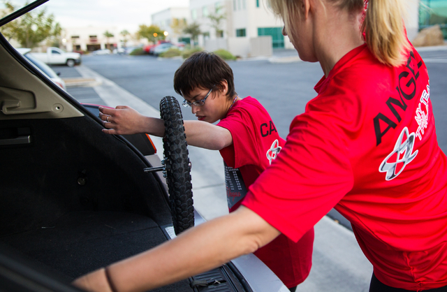 Eden Capsouto, right, and daughter Taylor Little, 20, put away parts of a jogging stroller after a run Thursday in preparation for Sunday's Rock 'n' Roll Las Vegas Half-Marathon. Little was  ...