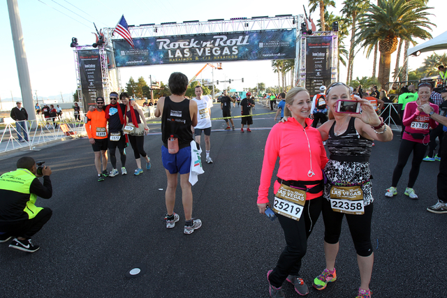 Leslie Browning, of Livermore, Calif., left, and Tam Loyd, CoCheyenne Wyo. take a photo of themselves before the start of the Zappos.com Half of the Half at the Rock 'N' Roll Las Vegas Marathon an ...