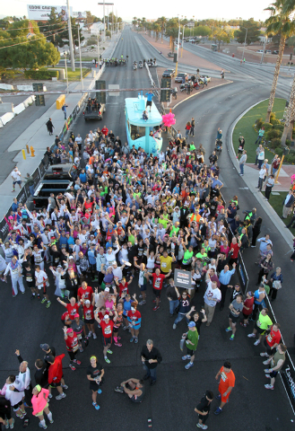 Brides and grooms pose for a photo before their wedding ceremony before the start of the Rock 'N' Roll Las Vegas Marathon and Half-Marathon on the Strip Sunday, Nov. 17, 2013. (K.M. Cannon/Las Veg ...