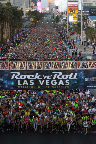 Runners cross the starting line at the start of the Rock ծՠRoll Las Vegas Marathon and Half-Marathon on the Strip Sunday, Nov. 17, 2013. (K.M. Cannon/Las Vegas Review-Journal)