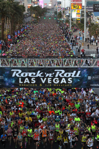 Runners cross the starting line at the start of the Rock & Roll Las Vegas Marathon and Half-Marathon on the Strip Sunday, Nov. 17, 2013. (K.M. Cannon/Las Vegas Review-Journal)