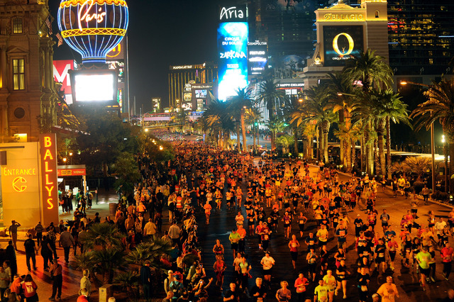 Runners take over The Strip during the Rock 'N' Roll Las Vegas Marathon on Sunday, Nov. 17, 2013. About 30,000 runners from all 50 states and 52 countries participated in the full and half maratho ...