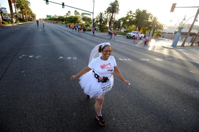 "A ""runaway bride,"" Dana Lewis of Atlanta, competes during the Rock 'N' Roll Las Vegas Marathon on Sunday, Nov. 17, 2013.  (David Becker/Las Vegas Review-Journal)"