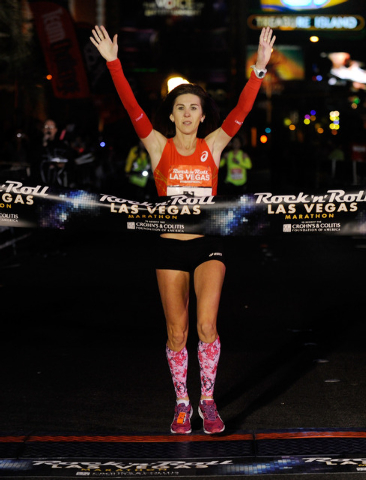 Nuta Olaru of Boulder, Colo., crosses the finish line first in the women's division during the Rock 'N' Roll Las Vegas Marathon on Sunday, Nov. 17, 2013. About 30,000 runners from all 50 states an ...