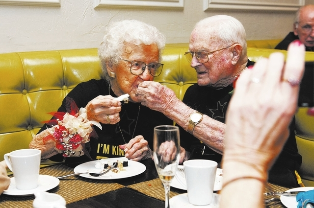 Edna Owings, 101, and her husband Harold, 102, eat cake during their 82nd wedding anniversary at Pasta Cucina restaurant inside Palace Station hotel-casino in Las Vegas on Tuesday, Nov. 26, 2013.  ...