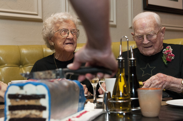 Edna Owings, 101, and her husband Harold, 102, are served cake during their 82nd wedding anniversary at Pasta Cucina restaurant inside Palace Station hotel-casino in Las Vegas on Tuesday, Nov. 26, ...