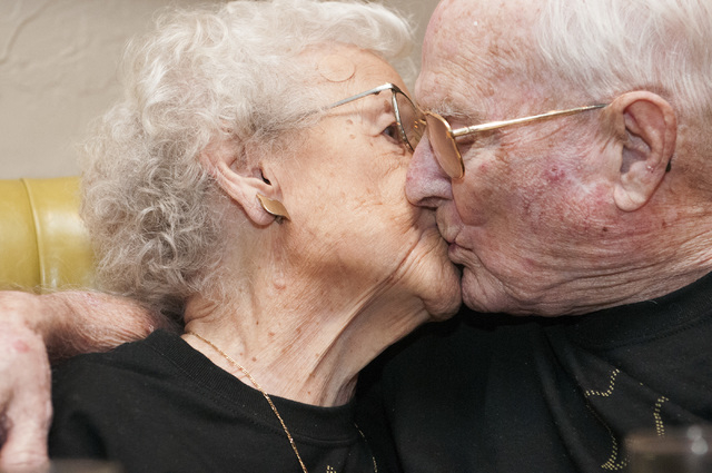 Edna Owings, 101, and her husband Harold, 102, kiss during their 82nd wedding anniversary dinner at Pasta Cucina restaurant inside Palace Station hotel-casino in Las Vegas on Tuesday, Nov. 26, 201 ...