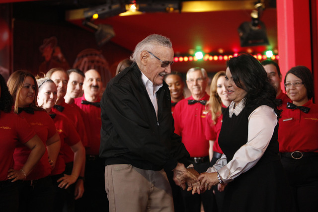 Stan Lee, left, speaks with General Manager Rosita Chapman during a ceremony to open new exhibits at Madame Tussauds in Las Vegas Wednesday, Dec. 20, 2013. (John Locher/Las Vegas Review-Journal)