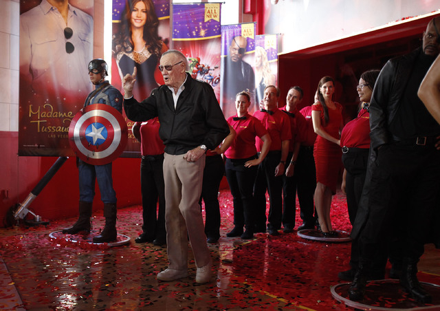 Stan Lee takes part in a ceremony to open new exhibits at Madame Tussauds in Las Vegas Wednesday, Dec. 20, 2013. (John Locher/Las Vegas Review-Journal)