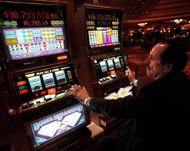 Lalo Goday, 66, from Orange County, California, plays two Megabucks machines at once at Mandalay Bay. (File, JEFF SCHEID/LAS VEGAS REVIEW-JOURNAL)