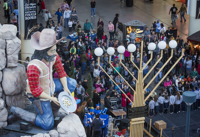 Crowds gather during the lighting of the menorah on Fremont Street and Fourth Street on Wednesday, Nov. 27,2013. This year the start of Hanukkah and Thanksgiving overlap. The last time this happen ...