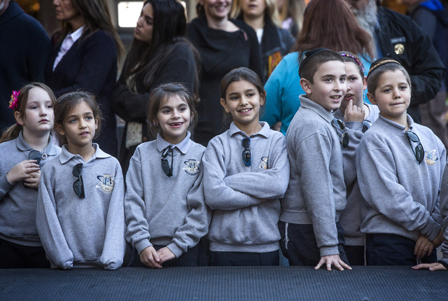 Students from the Desert Torah Academy gather during the lighting of the menorah on Fremont Street and Fourth Street on Wednesday, Nov. 27,2013. This year the start of Hanukkah and Thanksgiving ov ...