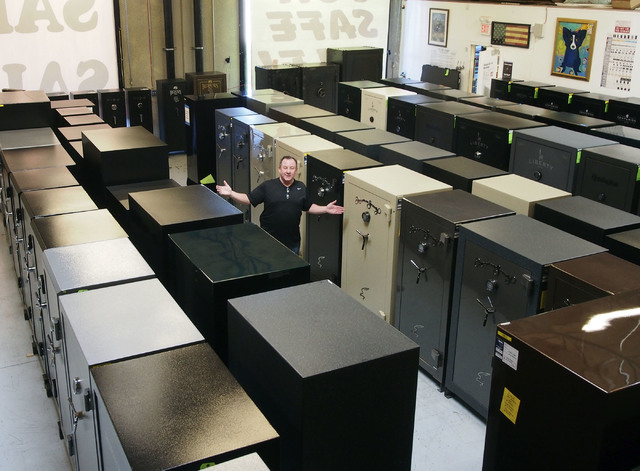 Retired Las Vegas Metro Captain James J. Dillon, Jr., shows off some of the hundreds of gun safes in his new business, Discount Gun Safe Warehouse, in Las Vegas, Wednesday, Nov. 13, 2013. (Jerry H ...