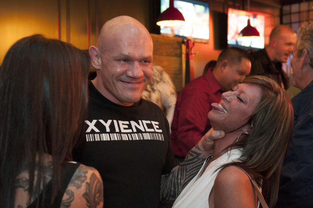 Chuck Liddell, Ultimate Fighting Championship fighter, poses for a photo with fans Penny Pedersen, right, and Wendi Dale at Michael Mina's Pub 1842 inside MGM Grand. (Erik Verduzco/Las Vegas Revie ...