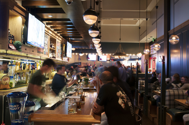Customers sit at the bar at Michael Mina's Pub 1842 inside the MGM Grand. (Erik Verduzco/Las Vegas Review-Journal)