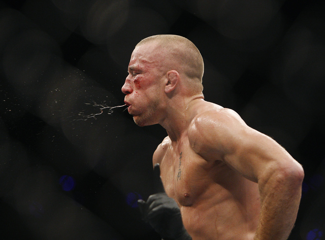 Georges St. Pierre exhales after defeating Johny Hendricks during UFC 167 at the MGM Grand Garden Arena in Las Vegas on Nov. 16, 2013. (Jason Bean /Las Vegas Review-Journal)