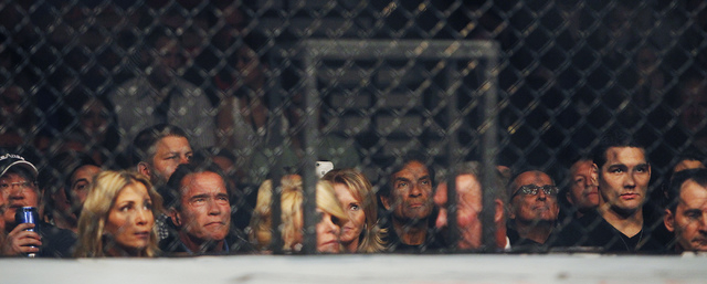Arnold Schwarzenegger, third from left, takes in the action during UFC 167 at the MGM Grand Garden Arena in Las Vegas on Nov. 16, 2013. (Jason Bean /Las Vegas Review-Journal)