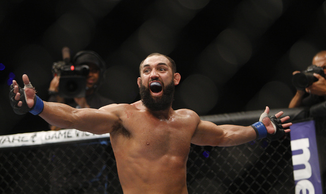 Johny Hendricks celebrates in the aftermath of his fight against Georges St. Pierre during UFC 167 at the MGM Grand Garden Arena on Nov. 16 St. Pierre won the fight by split decision. (Jason Bean  ...