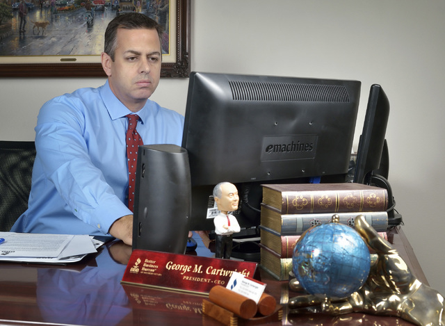 George Cartwright, president and CEO of the Better Business Bureau of Southern Nevada, works in his office at 6040 S. Jones Blvd. in Las Vegas on Thursday, Oct. 31, 2013. (Bill Hughes/Las Vegas Re ...