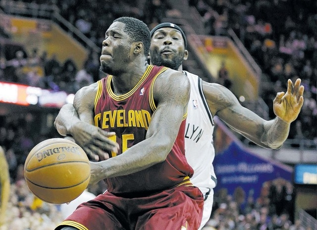 Anthony Bennett is fouled by Brooklyn's Reggie Evans during the Cavaliers' 98-94 win on Oct. 30 at Cleveland. The former UNLV star has struggled this season, going 0-for-15 from the field in f ...