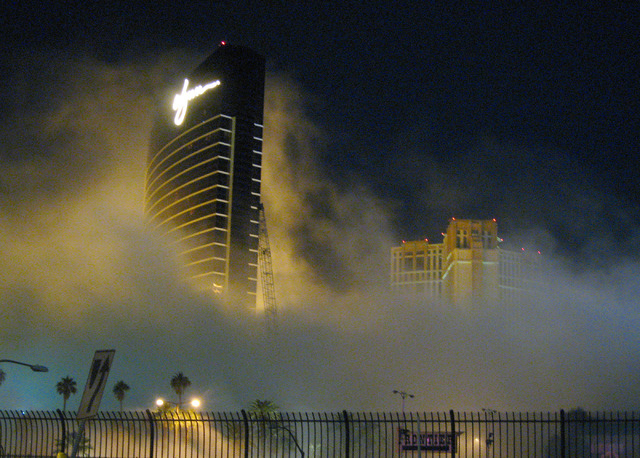 Smoke and dust shroud the Wynn Hotel-Casino across Las Vegas Boulevard after the implosion of the New Frontier Hotel-Casino on Tuesday, Nov. 13, 2007. (Mark Damon/Special to the Las Vegas Review-J ...