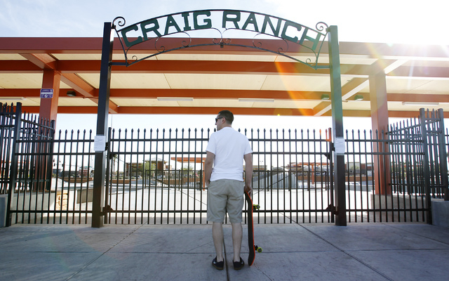 Steve Caracostas waits in front of the locked entrance to the skatepark at Craig Ranch Regional Park in North Las Vegas on Nov. 8, 2013.  The relatively new skatepark facility was temporarily clos ...