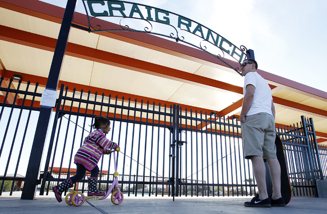 Steve Caracostas, right, and 3-year-old Senai'rie Ulufale wait in front of the locked entrance to the skatepark at Craig Ranch Regional Park in North Las Vegas on Nov. 8, 2013.  The relatively new ...