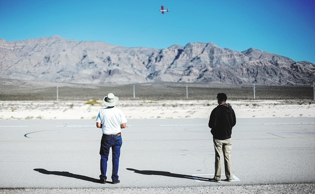 Pet Laffert, left, flies his radio controlled plane, seen above, at the Willie McCool Regional Airfield, home to the Prop Nuts Radio Controlled Airplane Club of North Las Vegas, on Saturday, Nov.  ...