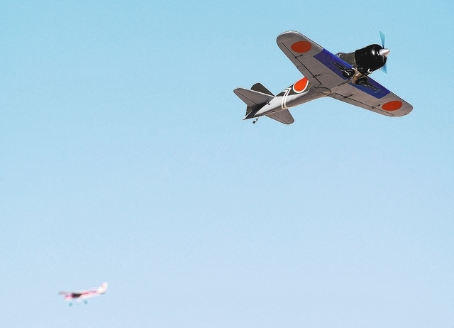 Radio controlled planes fly around at the Willie McCool Regional Airfield, home to the Prop Nuts Radio Controlled Airplane Club of North Las Vegas, on Saturday, Nov. 9, 2013. The club is slated to ...