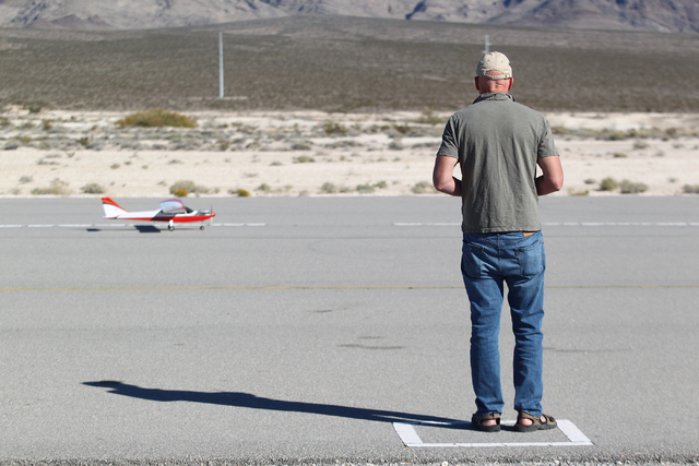 Bob Lowe prepares his radio controlled plane to fly at the Willie McCool Regional Airfield, home to the Prop Nuts Radio Controlled Airplane Club of North Las Vegas, on Saturday, Nov. 9, 2013. The  ...
