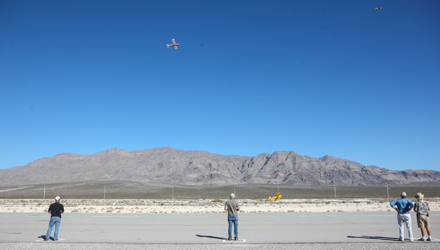 People fly their radio controlled planes at the Willie McCool Regional Airfield, home to the Prop Nuts Radio Controlled Airplane Club of North Las Vegas, on Saturday, Nov. 9, 2013. The club is sla ...