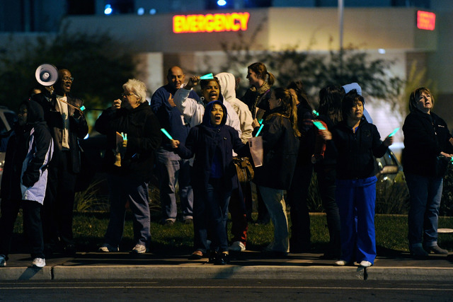 Nurses sing songs during a candlelight vigil outside Mountain View Hospital on Tuesday, Oct. 29, 2013. About two dozen nurses voiced their concerns with staffing issues and to demand management ta ...