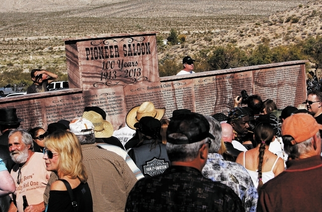 Patrons check out a new stone monument marking the 100th birthday of the Pioneer Saloon in Goodsprings on Oct. 19. (Jason Bean/Las Vegas Review-Journal)