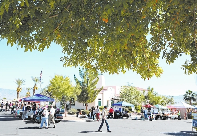Vendor tents are setup outside City Hall during the Gold Butte Days street festival Saturday, Oct. 19, 2013, in Mesquite, Nev. The festival, which took place in the center of the town and was orga ...