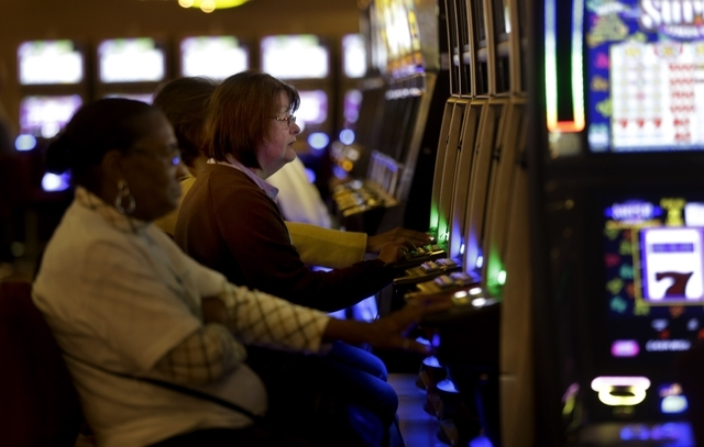 People gamble at the Monticello Casino and Raceway in Monticello, N.Y., Wednesday, Nov. 6, 2013. New York voters approved an amendment to the state constitution on Tuesday, Nov. 5, that authorizes ...