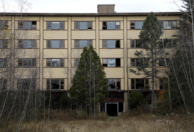 An abandoned building is seen on the grounds of Grossinger's Resort in Liberty, N.Y., Wednesday, Nov. 6, 2013. Voters approved an amendment to the state constitution that authorizes seven Las Vega ...