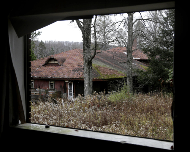 Abandoned and decrepit building dot the property of Grossinger's Resort in Liberty, N.Y., Wednesday, Nov. 6, 2013. Voters on Tuesday approved an amendment to the state constitution that authorizes ...