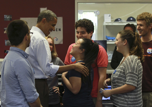 President Barack Obama greets supporters during a surprised visit to the Obama for America field office in Henderson, Nev.,  Monday, Oct. 1, 2012. (Jeff Scheid/Las Vegas Review-Journal)