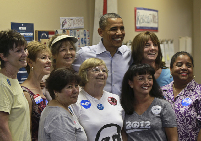 President Barack Obama poses for photos during a surprise visit to the Obama for America field office in Henderson, Nev. on Monday, Oct. 1, 2012. (Jeff Scheid/Las Vegas Review-Journal)