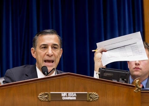 House Oversight Committee Chairman Rep. Darrell Issa, R-Calif., holds up a checklist related to the preparation for the implementation of the Obamacare health care program, and specifically, the H ...