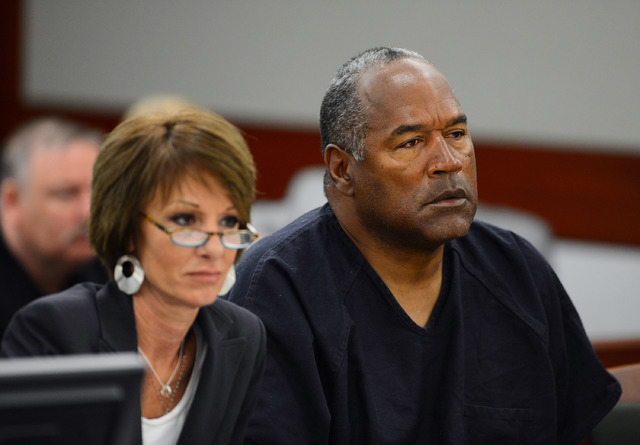 Defense attorney Patricia Palm, left, and O.J. Simpson appear at an evidentiary hearing in Clark County District Court on May 17, 2013 in Las Vegas. Simpson, who is currently serving a nine-to-33- ...
