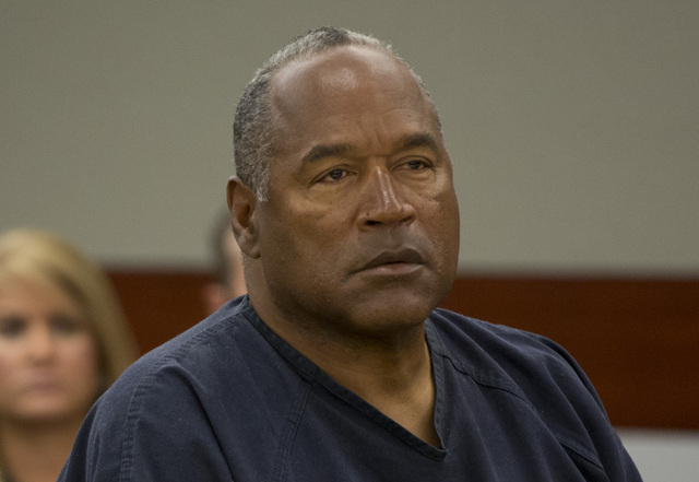 O.J. Simpson listens to audio recording played during an evidentiary hearing in Clark County District Court, Thursday, May 16, 2013 in Las Vegas. Simpson, who is currently serving a nine to 33-yea ...