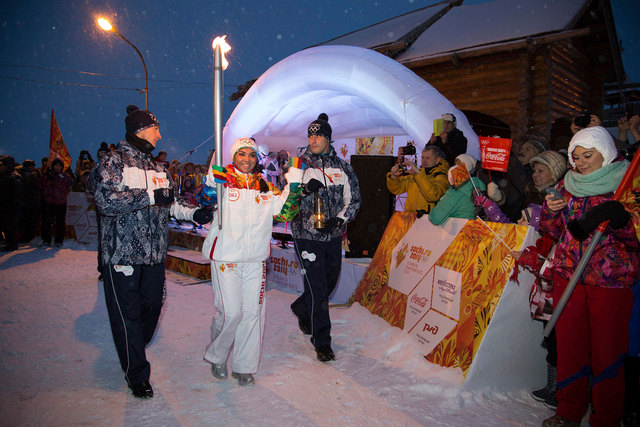 Torchbearer Marina Kaneva holds her Olympic torch on Monday near Salekhard, some 1,180 miles northeast of Moscow. The torch for the Sochi Winter Games will go into space on Thursday with a crew bo ...