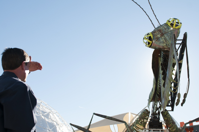 A grasshopper sculpture overlooks the entrance to Container Park in downtown Las Vegas during its opening Monday, Nov. 25, 2013. (Erik Verduzco/Las Vegas Review-Journal)