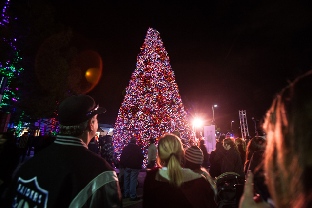 Attendees look at the tree after it is lit by Mayor Carolyn Goodman at the Magical Forest at Opportunity Village in Las Vegas on Friday. (Chase Stevens/Las Vegas Review-Journal)