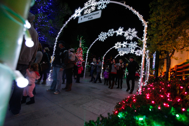 People make their way through the Magical Forest at Opportunity Village in Las Vegas on Friday. (Chase Stevens/Las Vegas Review-Journal)
