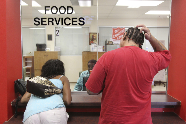 Two people, who declined to give their names, apply for food assistance at the Salvation Army Family Services office in September. (K.M. Cannon/Las Vegas Review-Journal)
